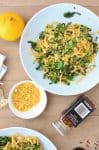 Collard Green Pasta! Shredded collards tossed with hot pasta, garlic, olive oil, red pepper flakes and seasoned bread crumbs. Dinner is ready in just 20 minutes! Vegan   www.delishknowledge.com