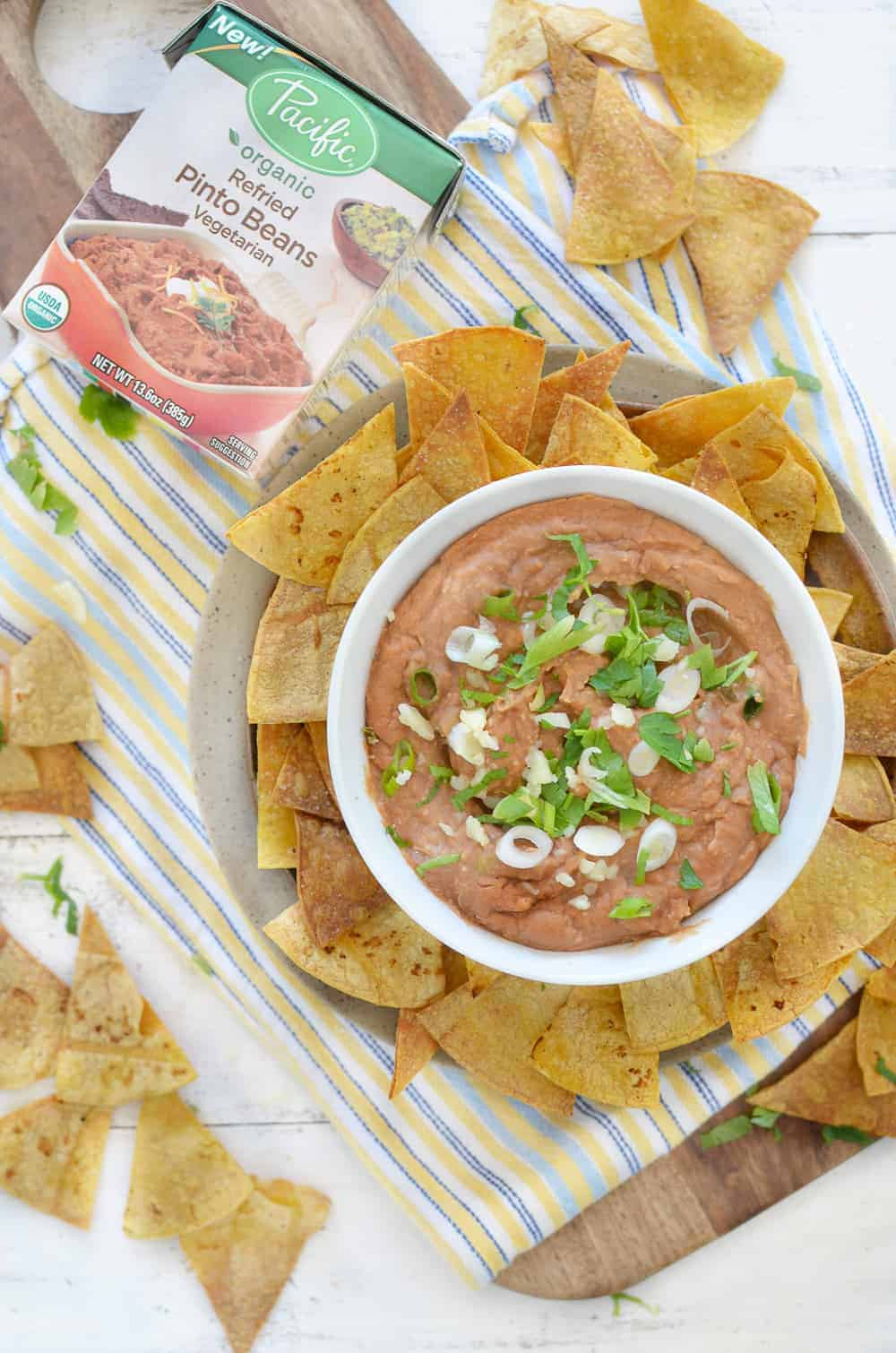 15 minute Spicy Bean Dip with Homemade Tortilla Chips! A must-make for tailgates, football games, and parties! Save this one when you need a fast, healthy appetizer option. #vegetarian #glutenfree   www.delishknowledge.com