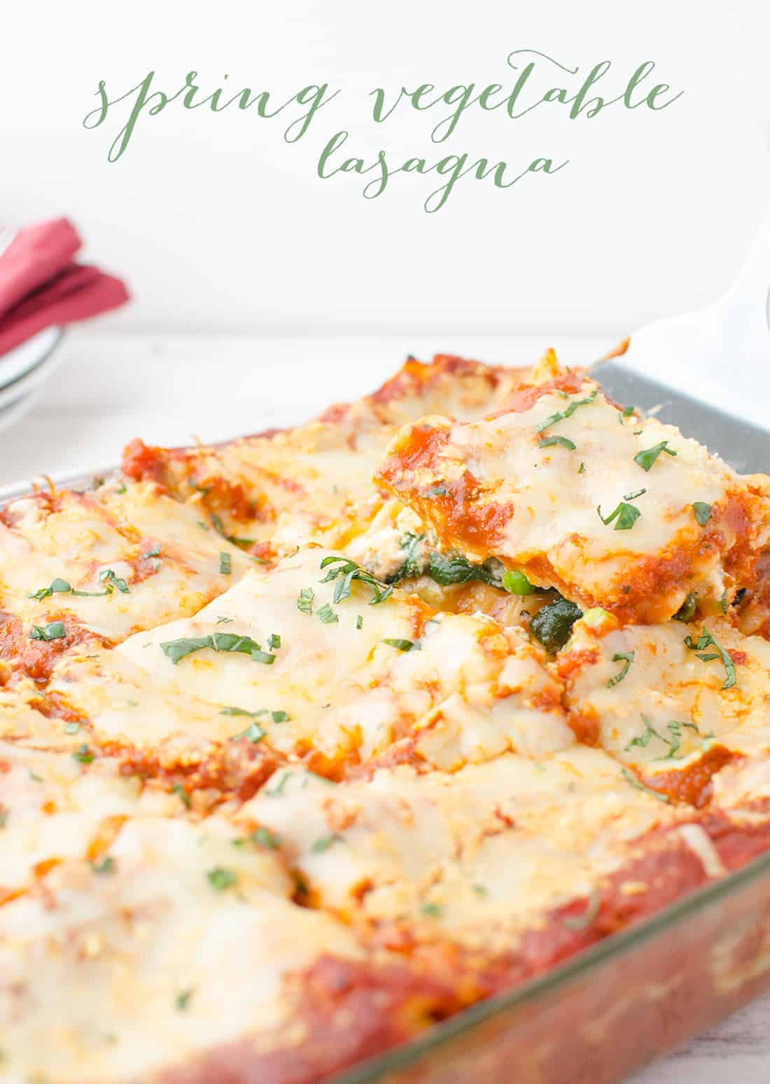 Spring Vegetable Lasagna! Layers of zucchini, spinach, peas and creamy ricotta. Less than 350 calories per HUGE slice. #vegetarian | delishknowledge.com