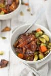 Vegan BBQ tempeh Bowl! BBQ roasted tempeh with crispy brussels sprouts and carrots. Served with wild rice. Vegan and Gluten-Free | www.delishknowledge.com