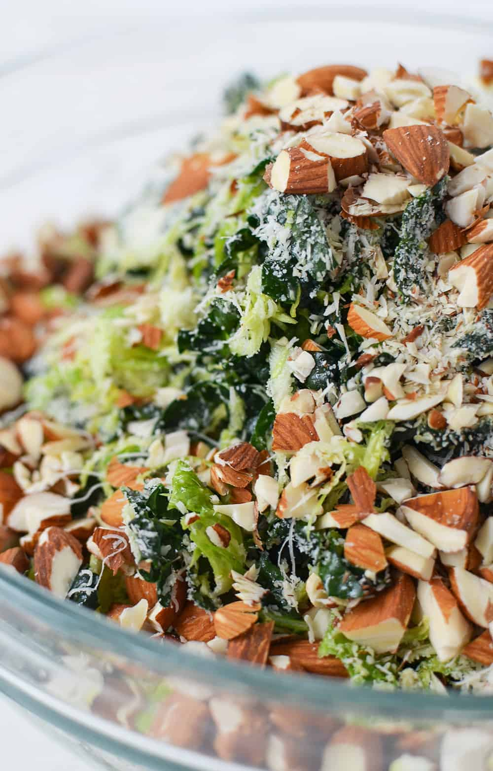 Shredded Brussels Sprouts Salad with Toasted Almonds and Grated Parmesan. The BEST salad, perfect for Thanksgiving and the holidays! You must make this one. | www.delishknowledge.com