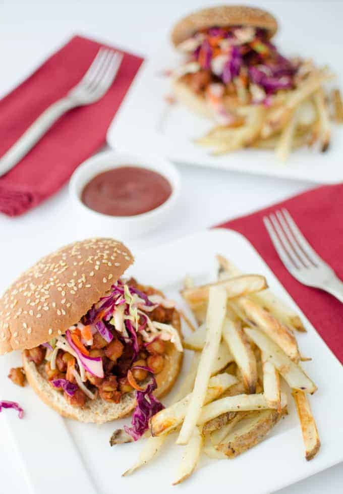 Vegan BBQ! Chickpeas smothered in a smoky, spicy BBQ sauce topped with a healthy, dairy-free rainbow slaw. Perfect football appetizers or weekend lunch!