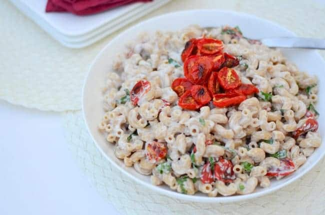Pasta with creamy, dairy-free cauliflower sauce, roasted cherry tomatoes and ribbons of basil