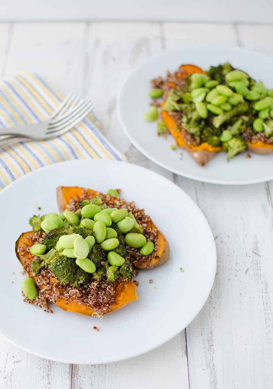 Curry Stuffed Sweet Potatoes! Such a healthy and delicious meal! Baked sweet potatoes topped with quinoa, broccoli, and edamame. Topped with a red curry peanut sauce.