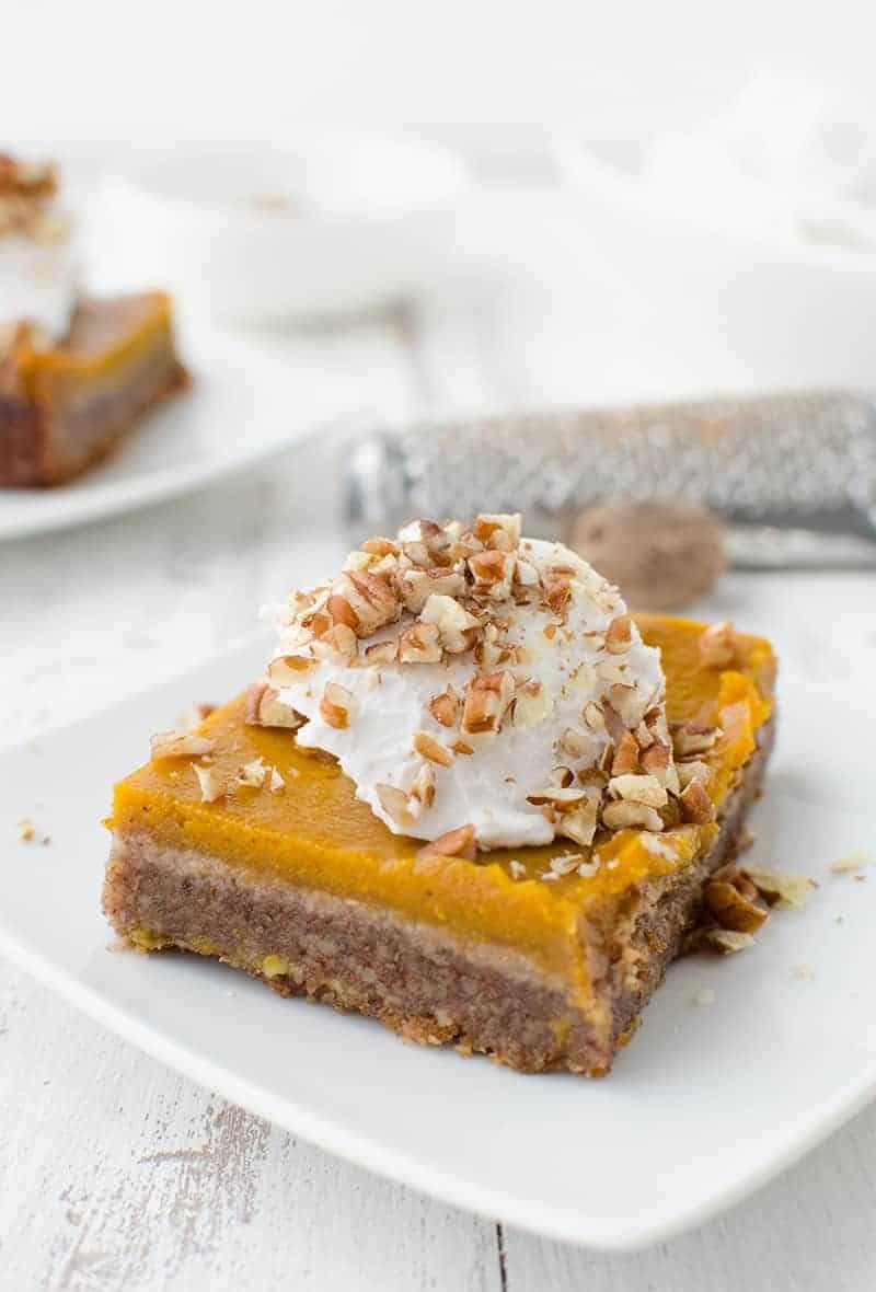 Vegan & Gluten-Free Pumpkin Pie Pecan Bars! Now you don't have to choose between pies! Topped with Cinnamon-Vanilla Coconut Cream.   www.delishknowledge.com