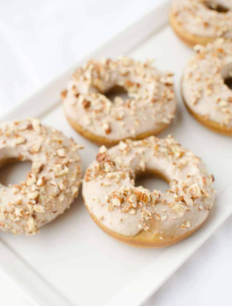 Pumpkin Donuts with Maple-Pecan Frosting! A healthy take on donuts! Save this one for company this fall!