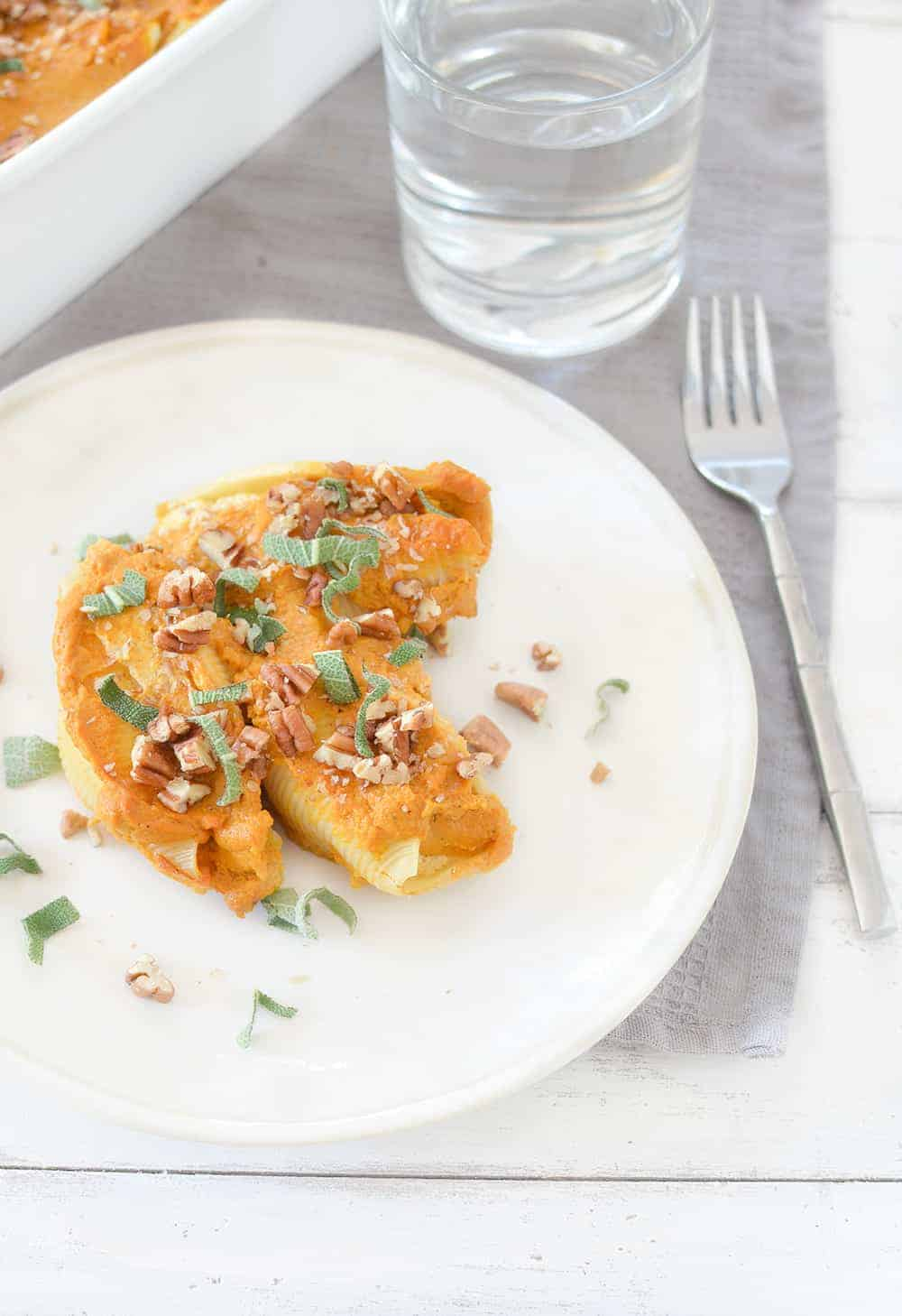 Vegan Stuffed Shells with Pumpkin Cream Sauce! Tofu ricotta stuffed into jumbo shells and baked in a creamy pumpkin sauce. Showstopper dinner for the holidays!   www.delishknowledge.com