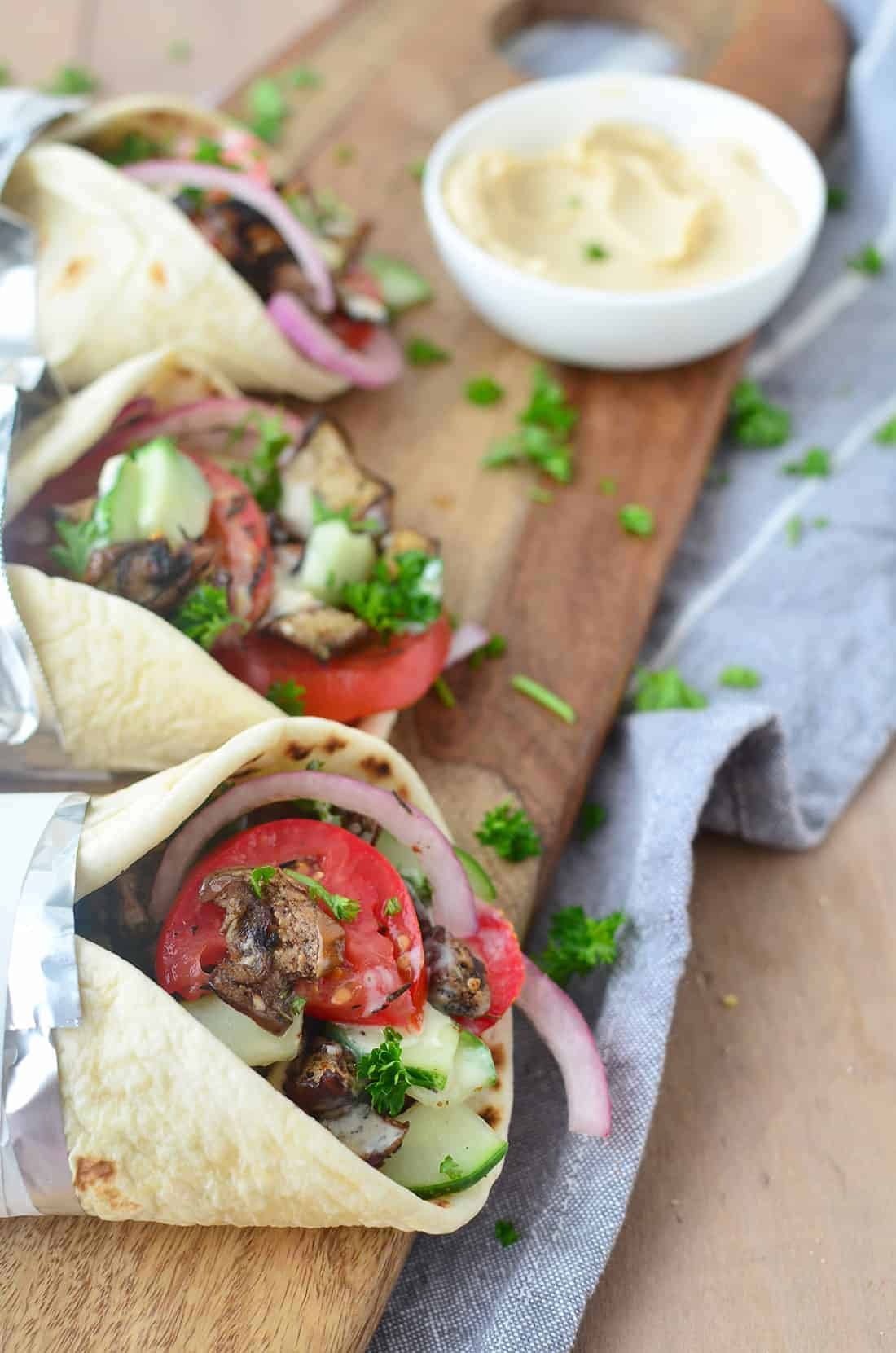 You'd never guess this was vegan! Meaty eggplant gyros stuffed with vegetables, herbs and the best hummus sauce. So good! #vegan #vegetarian | www.delishknowledge.com